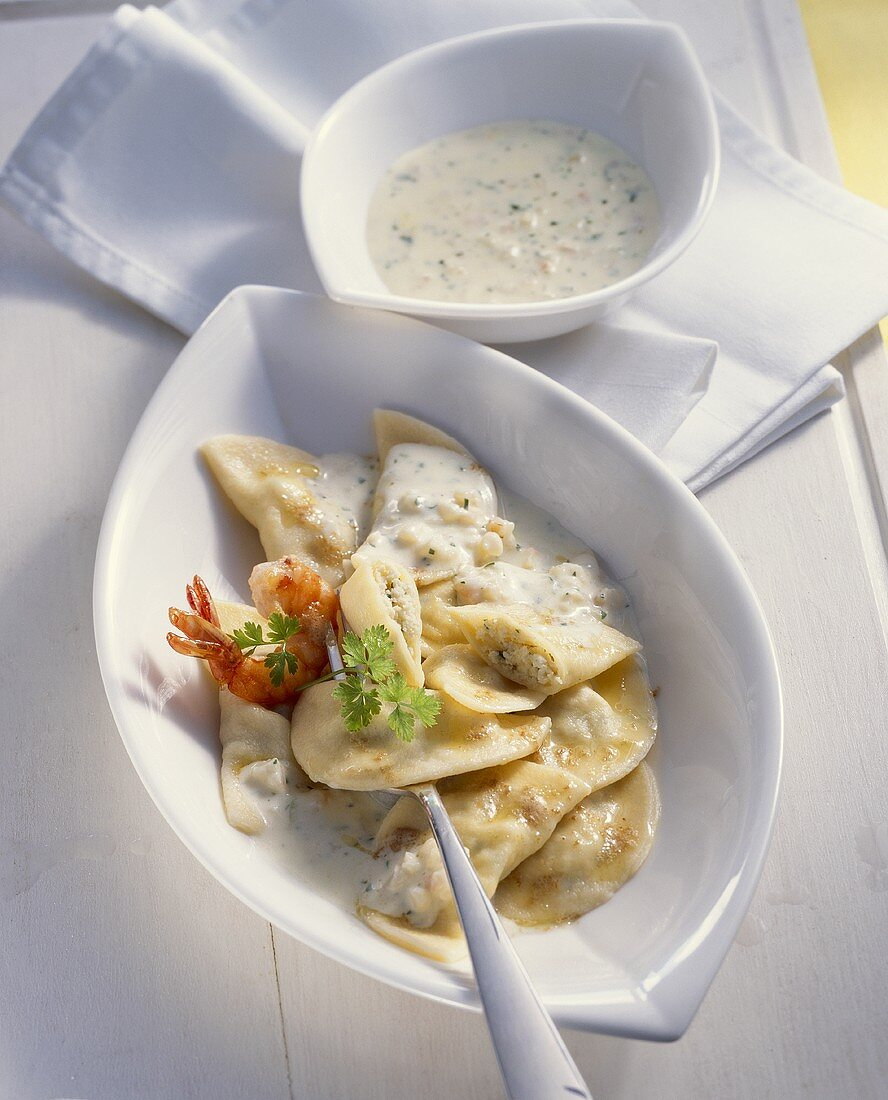 Ravioli with fish and seafood filling and shrimp sauce
