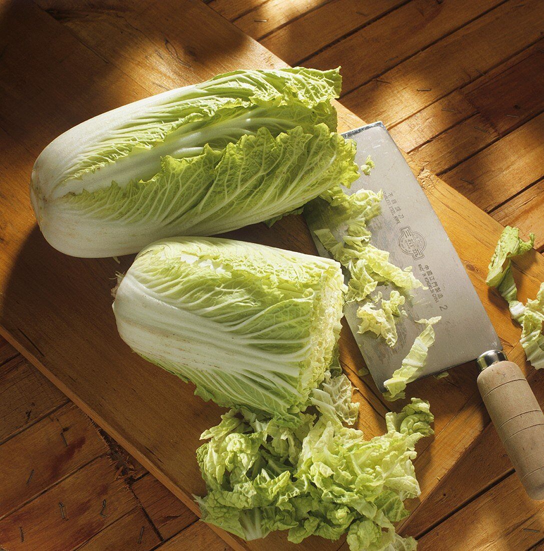 Whole and cut Chinese cabbage with cleaver
