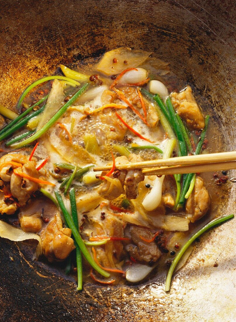 Spicy chicken thighs with spring onions and chilis