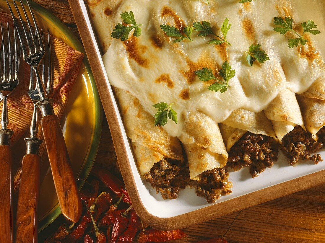 Baked pancakes with mince filling