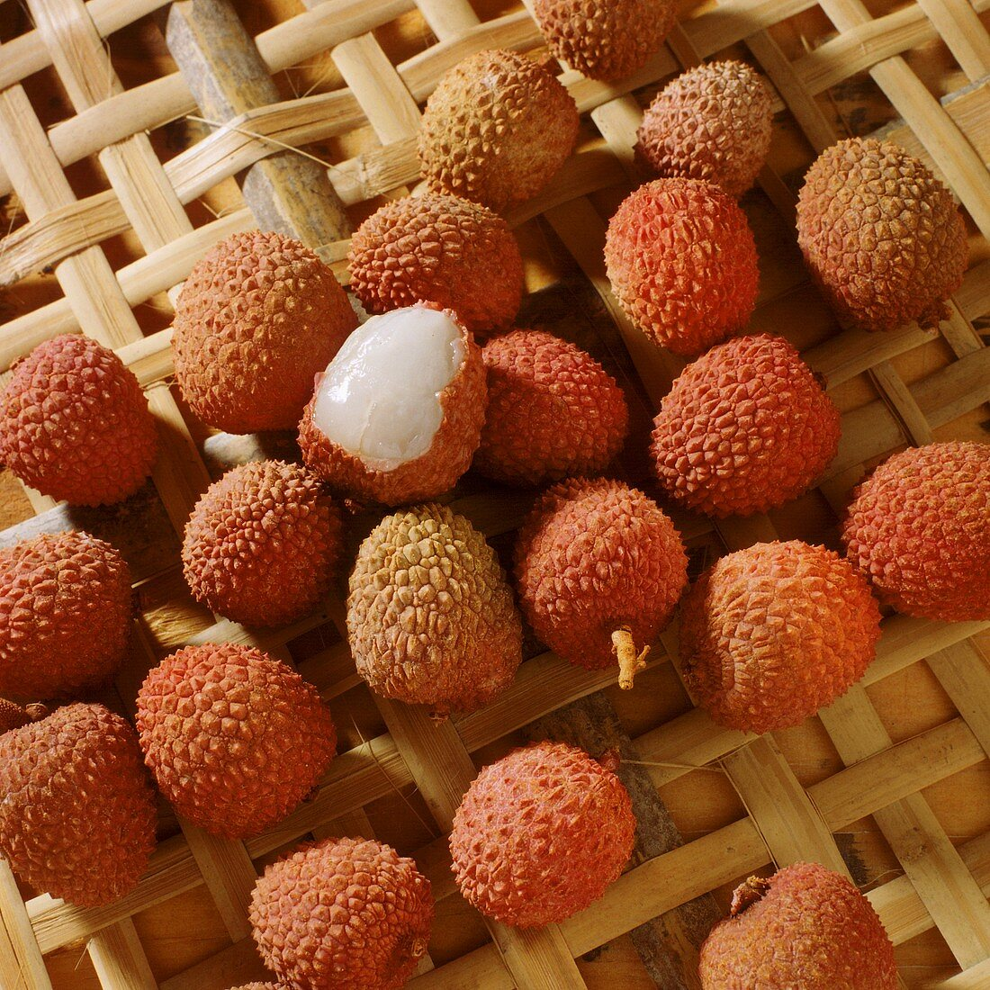 Several lychees on plaited background