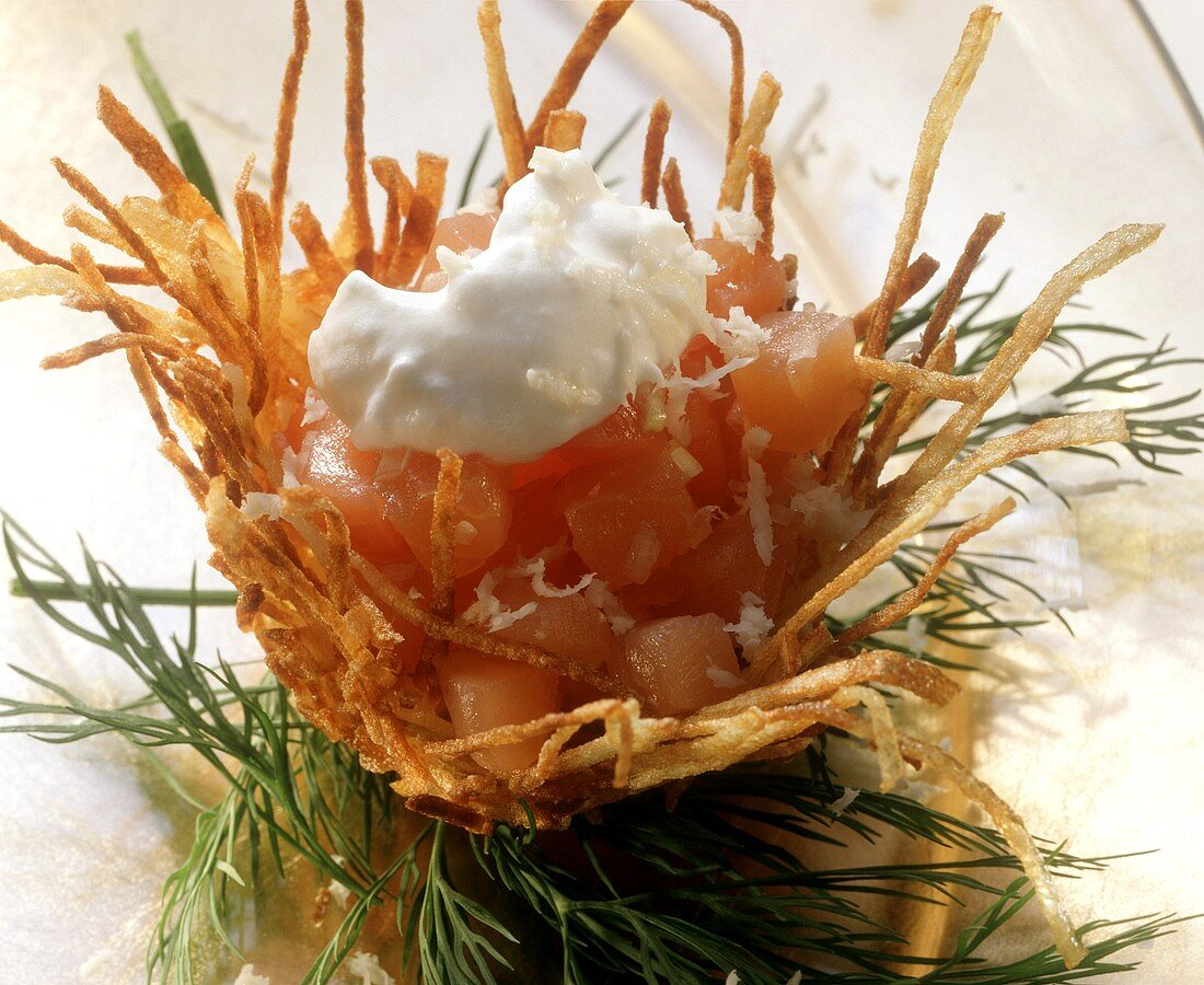 Diced smoked salmon in potato nest