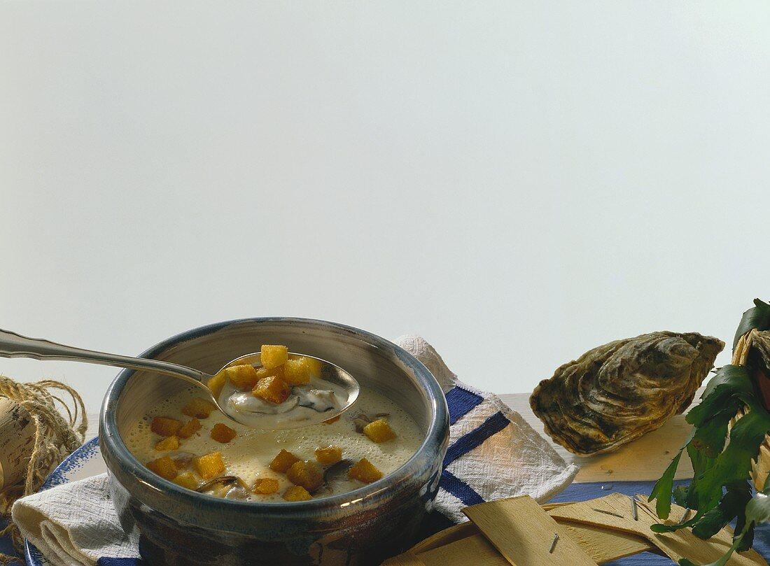 Creamed onion soup with oysters and toasted croutons