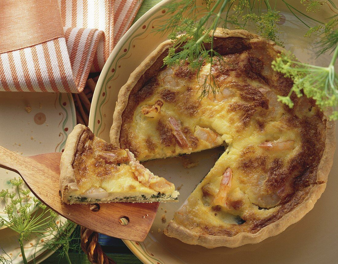 Chard quiche with shrimps and sprigs of dill