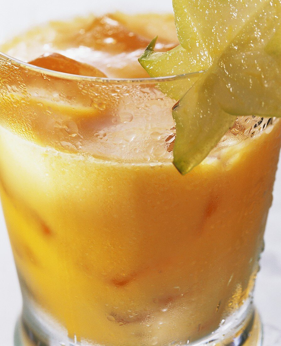 Exotic fruit on the rocks with carambola on glass & ice cubes