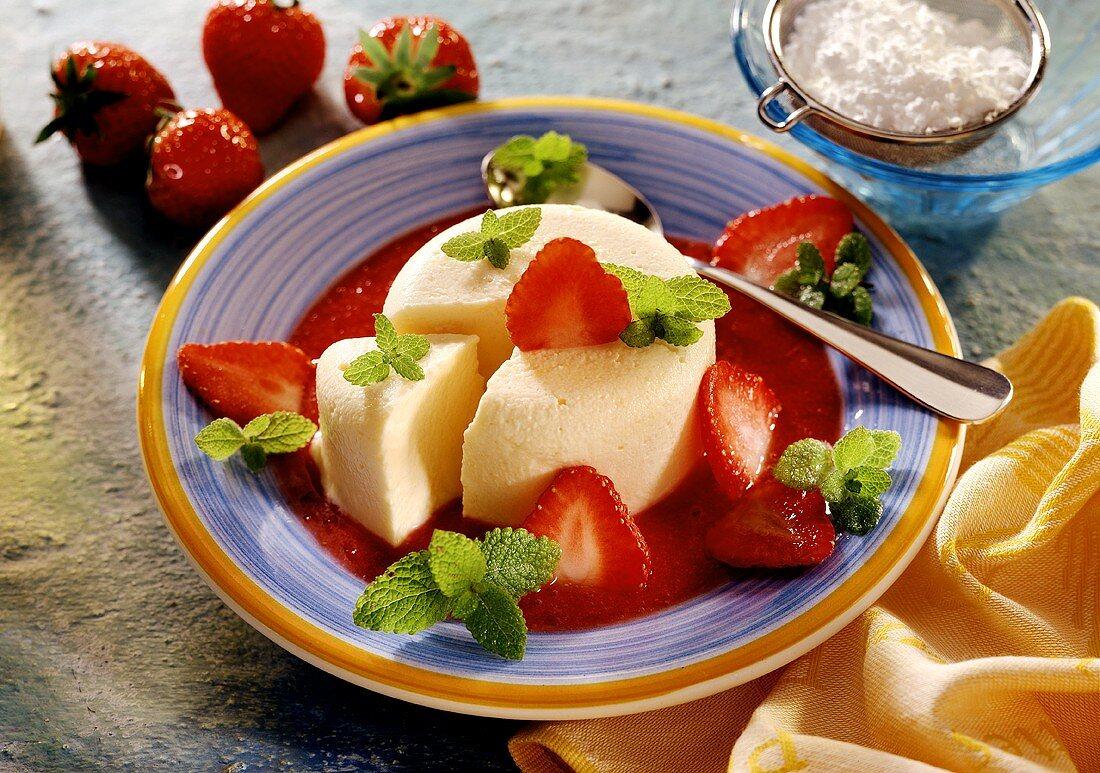 Advocaat parfait on strawberry sauce, strawberries & mint