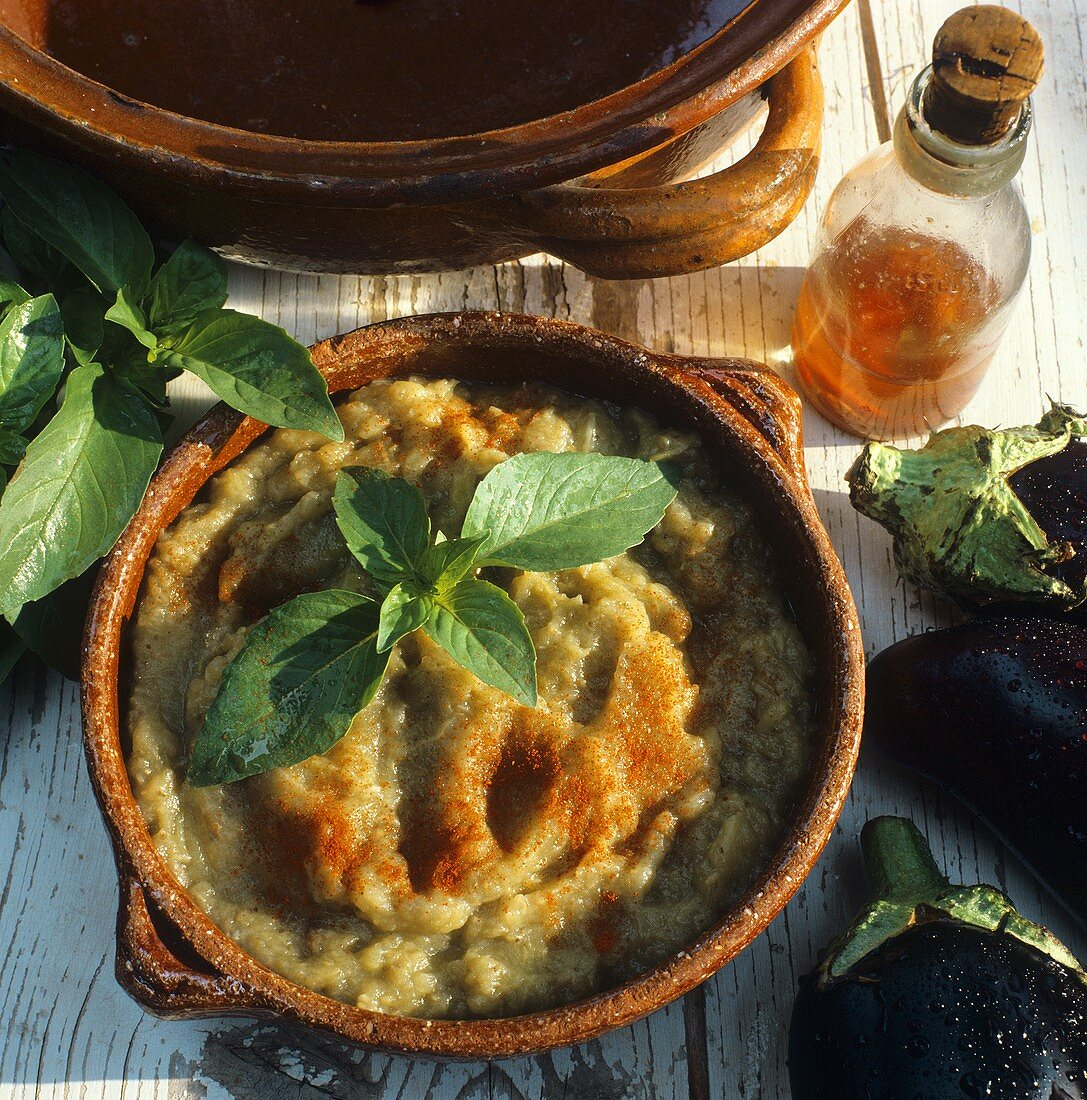 Aubergine puree with paprika and herb sprig