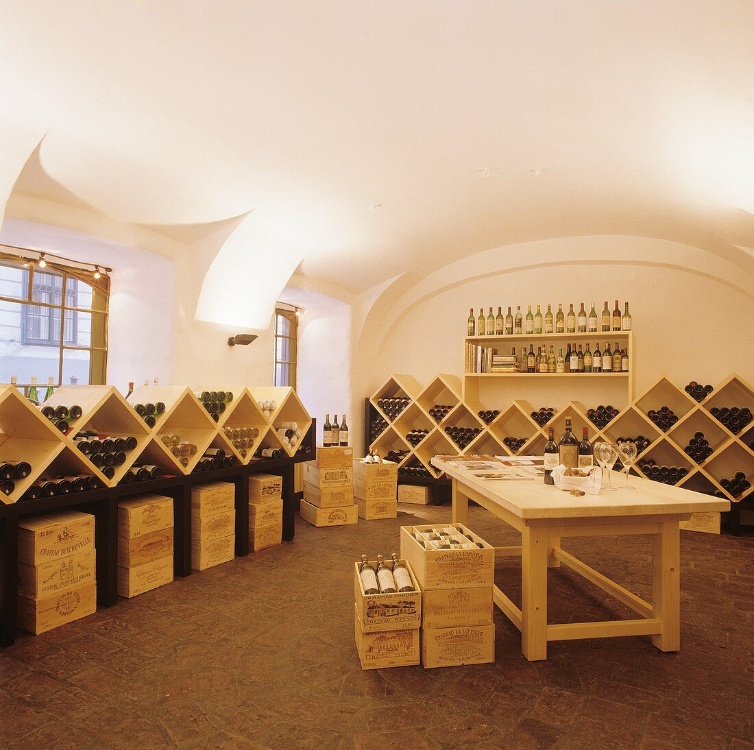 Wine merchants with wine bottles in racks and crates