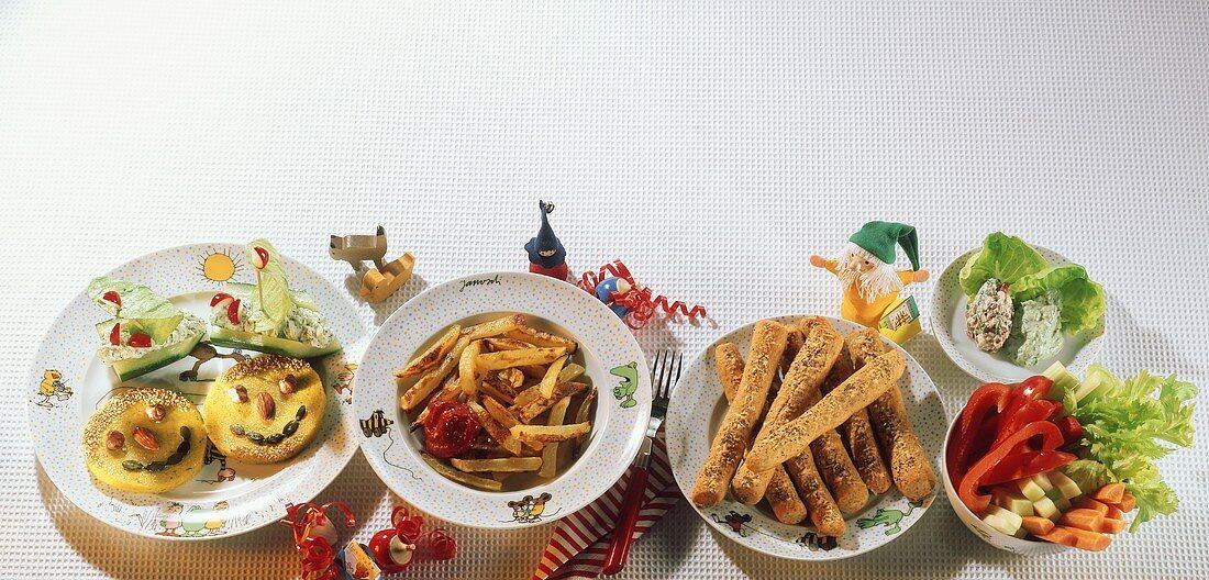 Menu: polenta faces, chips, cheese sticks, raw vegetables