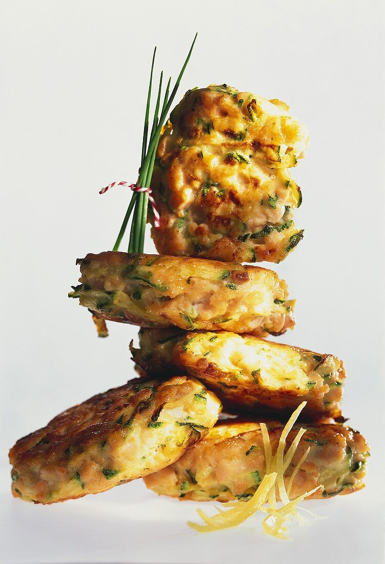 Salmon rissoles with tarragon and mustard butter, in a pile