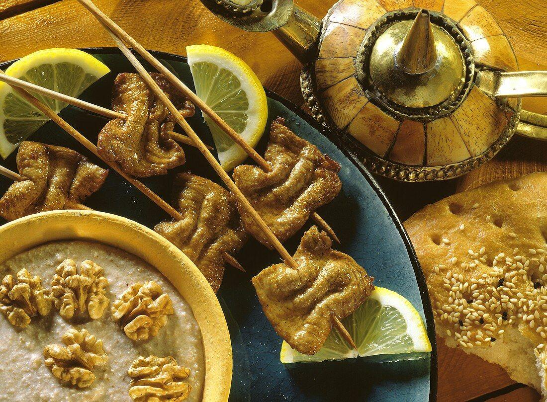 Fondue with Moorish meat kebabs and walnut sauce