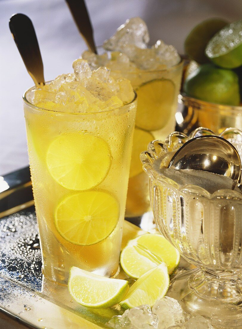 Cold punch (Kalte Ente) with lemon & crushed ice in glasses