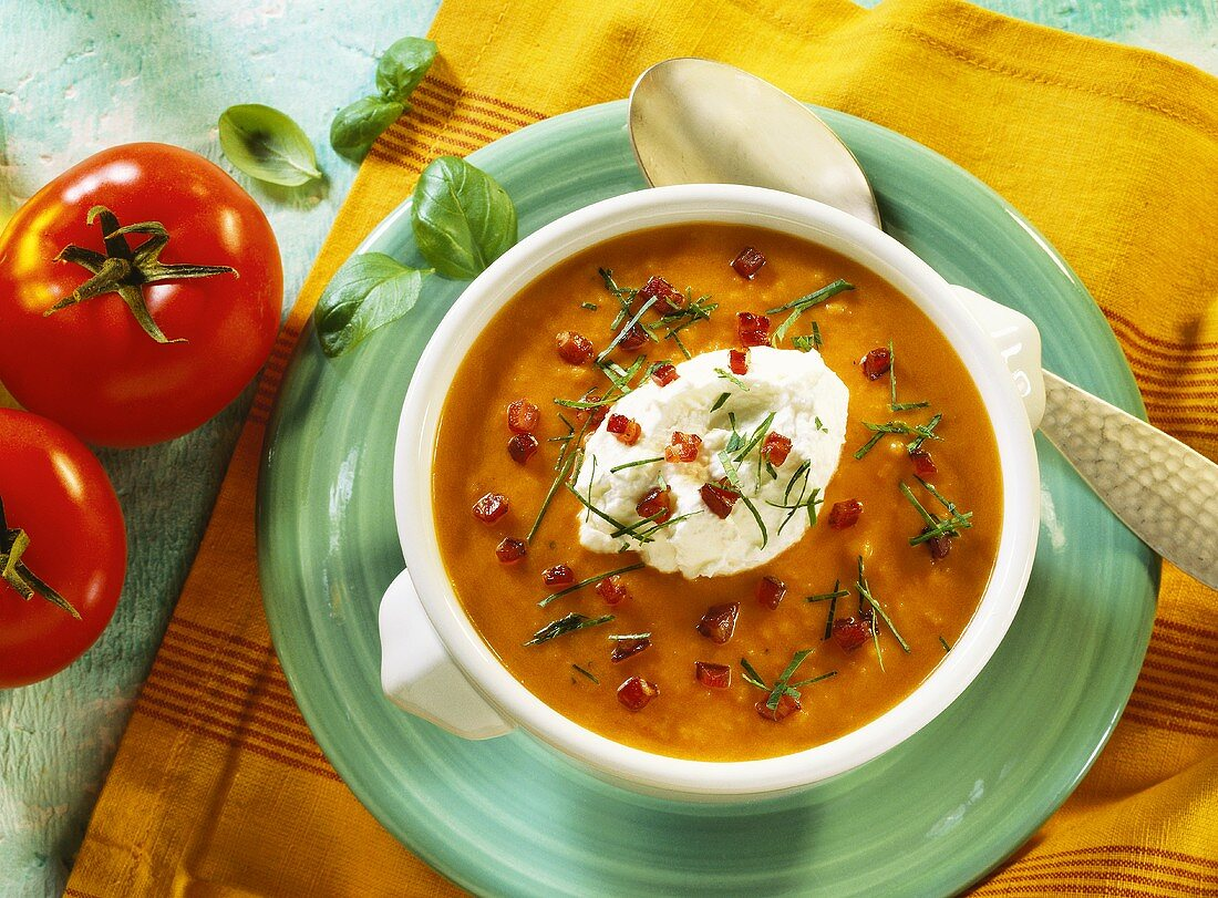 Tomato & potato soup with bacon, cream & basil strips