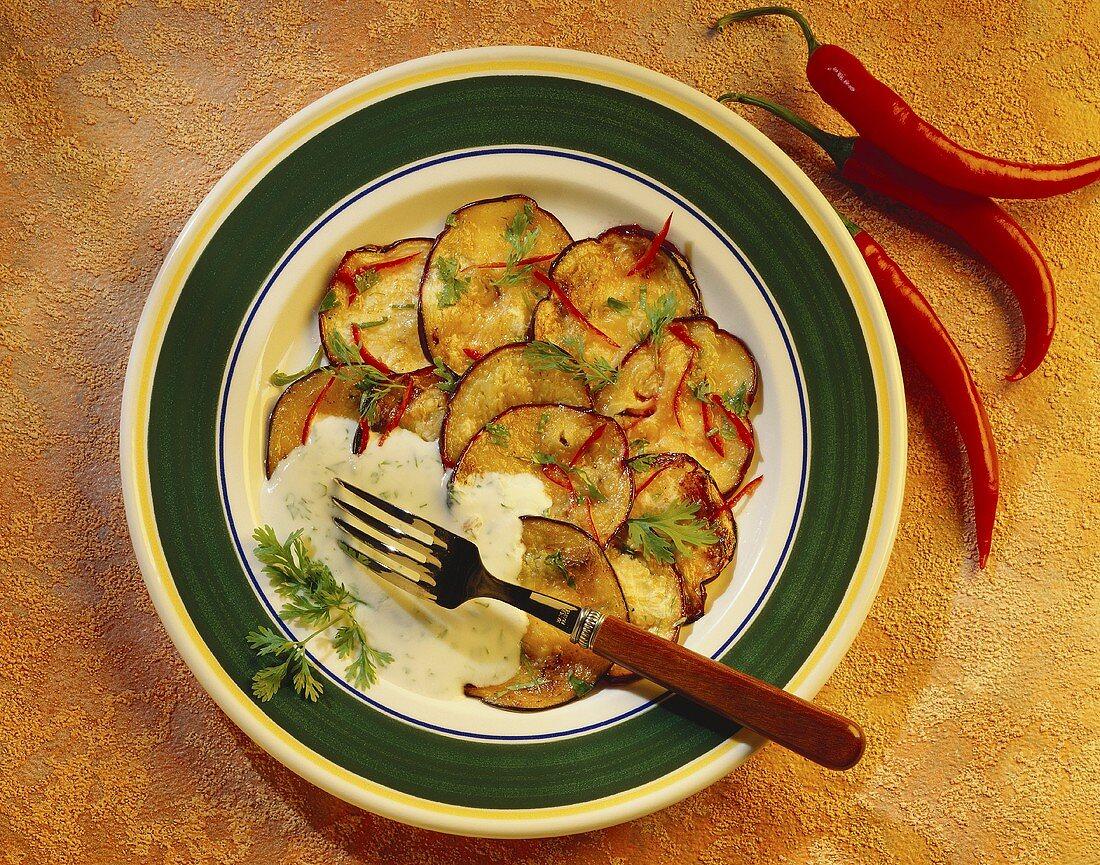 Aubergine salad with coriander yoghurt sauce and chilis