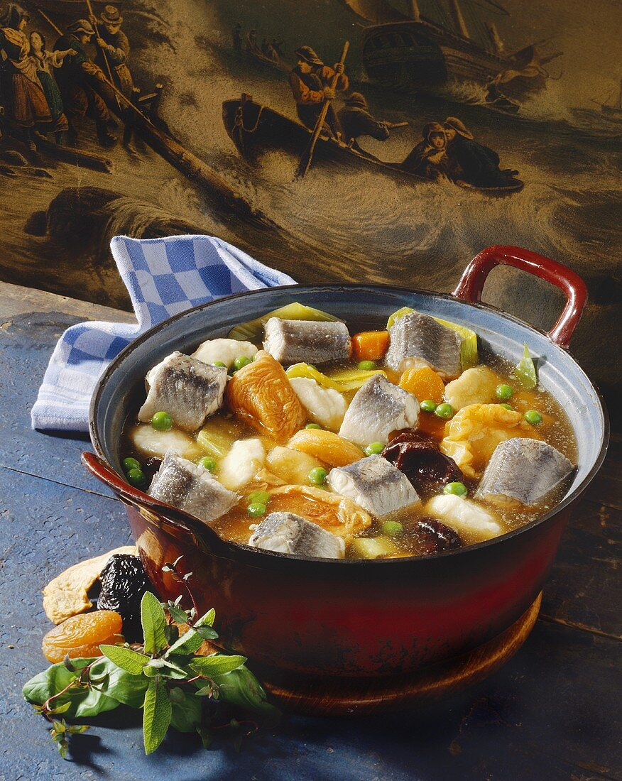 Hamburg eel soup with dried fruit in pot in front old painting