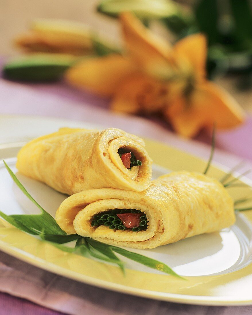 Noodle omelette with cheese, filled with chives & tomatoes