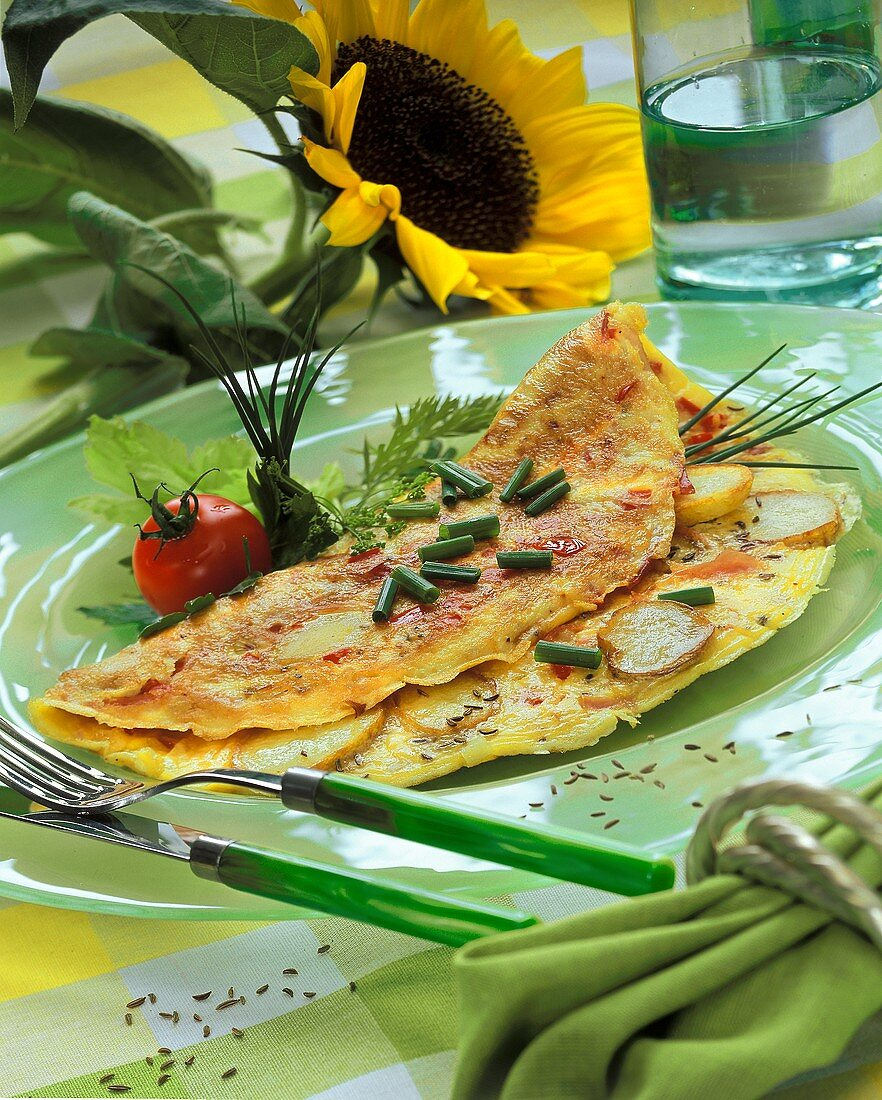 Peasant's breakfast with chives on green plate