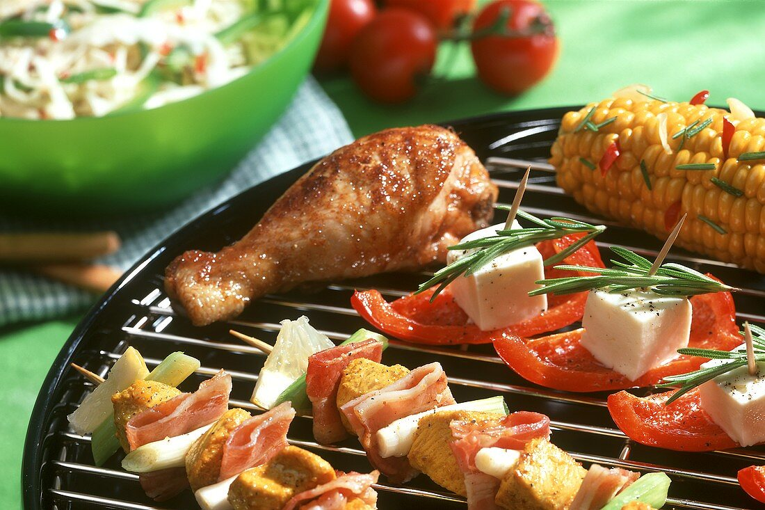 Tandoori kebabs with bacon, chicken thighs etc on a grill