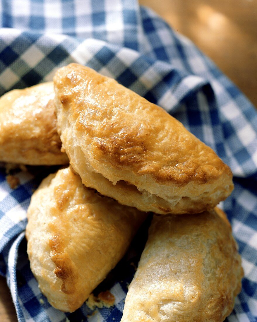 Apple pasties with quark puff pastry on checked cloth