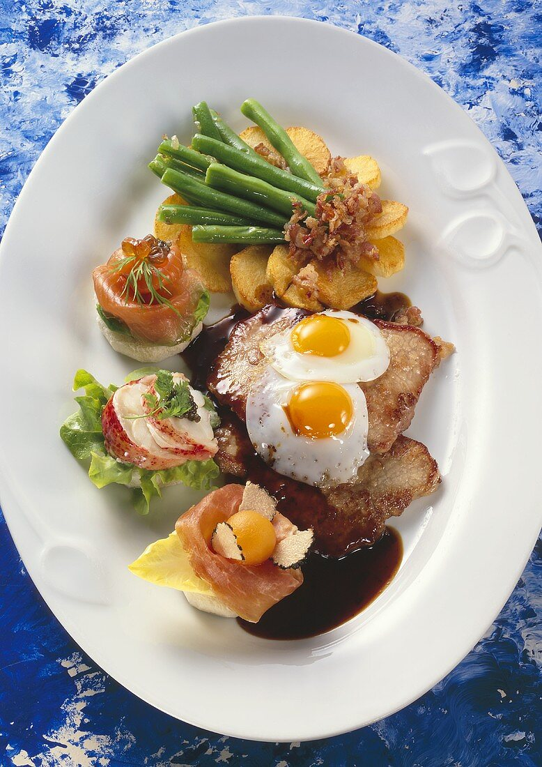 Holstein escalope with fried egg, fried potatoes and canapés