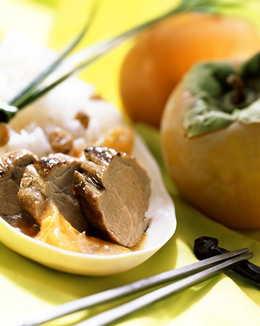 Pork in sharon fruit sauce with raisin rice; chopsticks