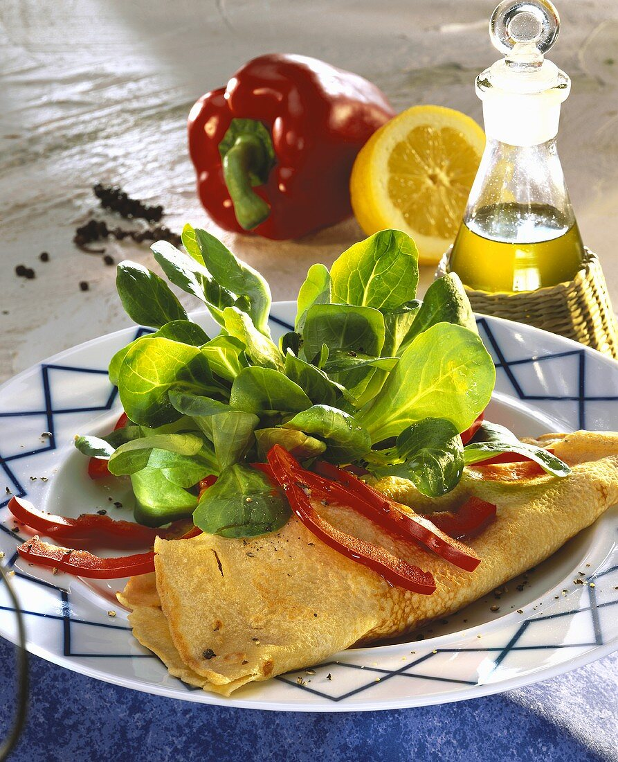Buckwheat pancake with corn salad and peppers