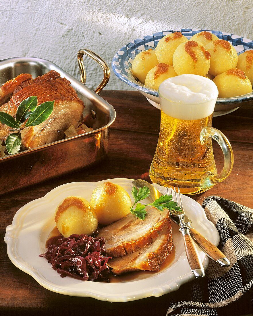 Roast pork with potato dumplings, red cabbage and beer