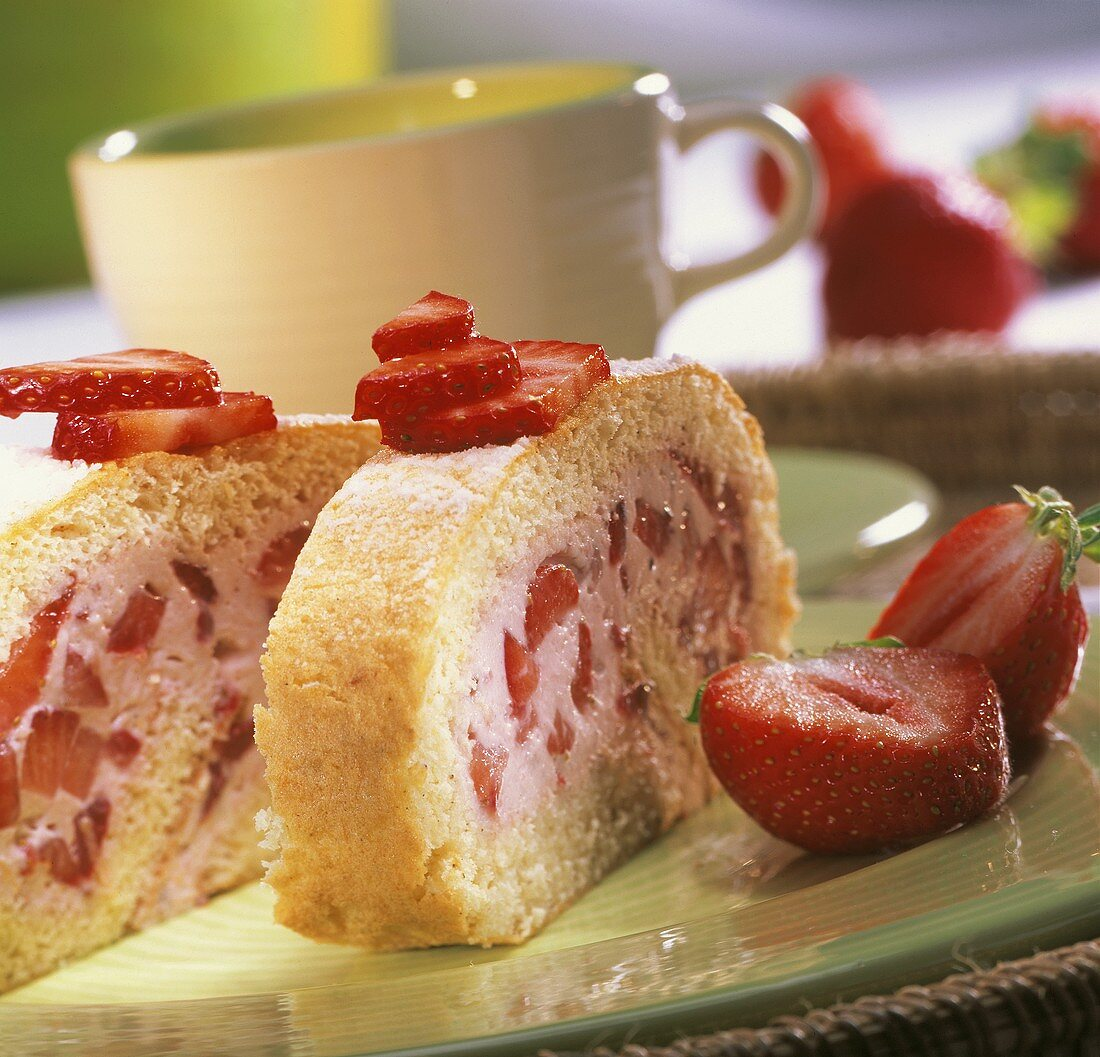 Sponge roulade with strawberry and lemon filling