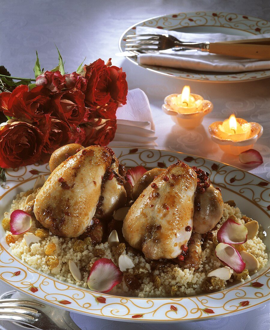 Poussin with couscous and rose petals; Candles