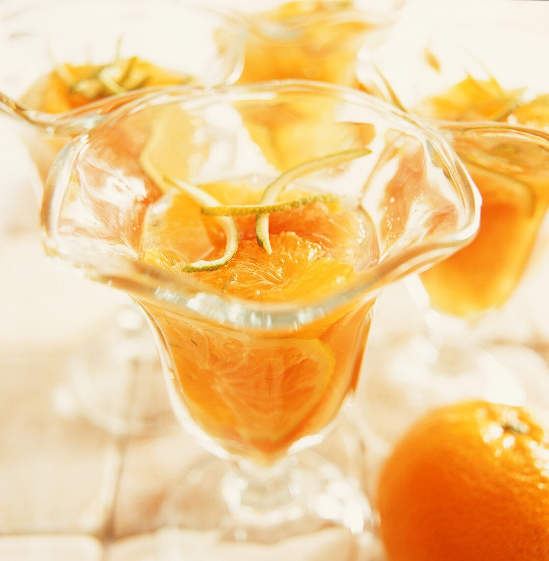 Orange dessert with lime zest in glass dishes