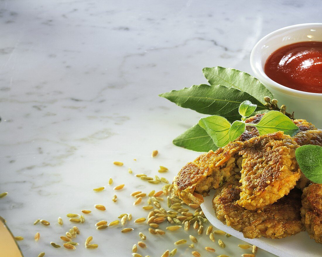 Vegetable and green rye burgers on a plate; Tomato ketchup