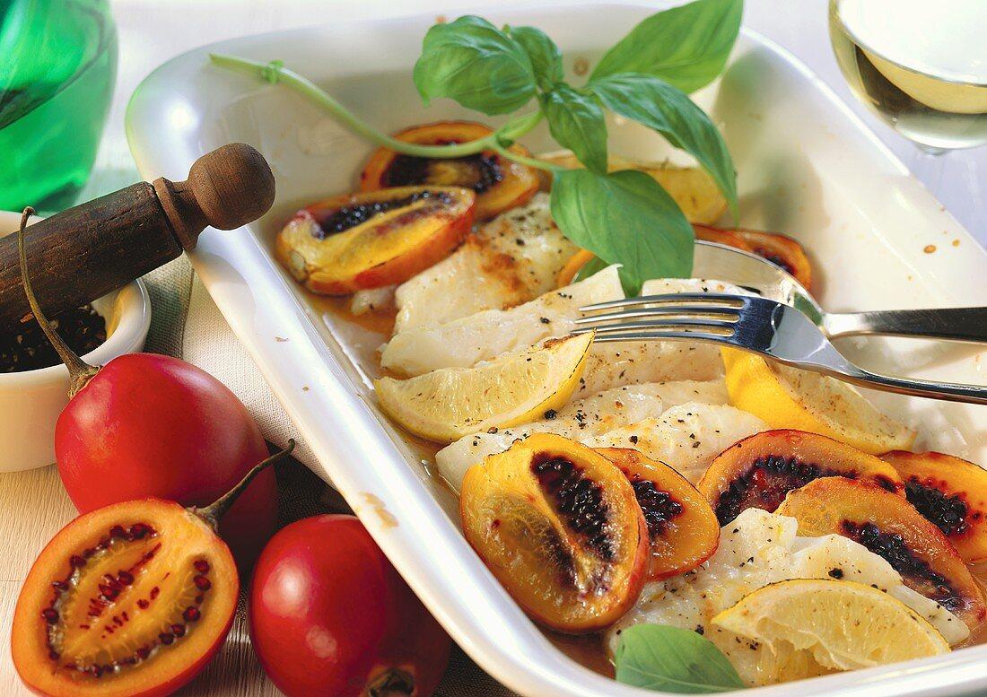 Cod with tamarillos and lemons in baking dish