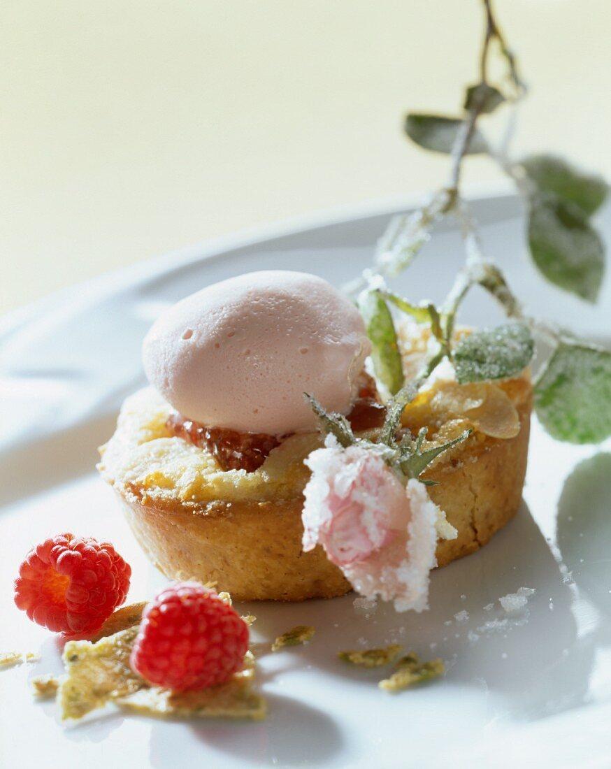 Crispy almond sponge with raspberries and rose ice cream
