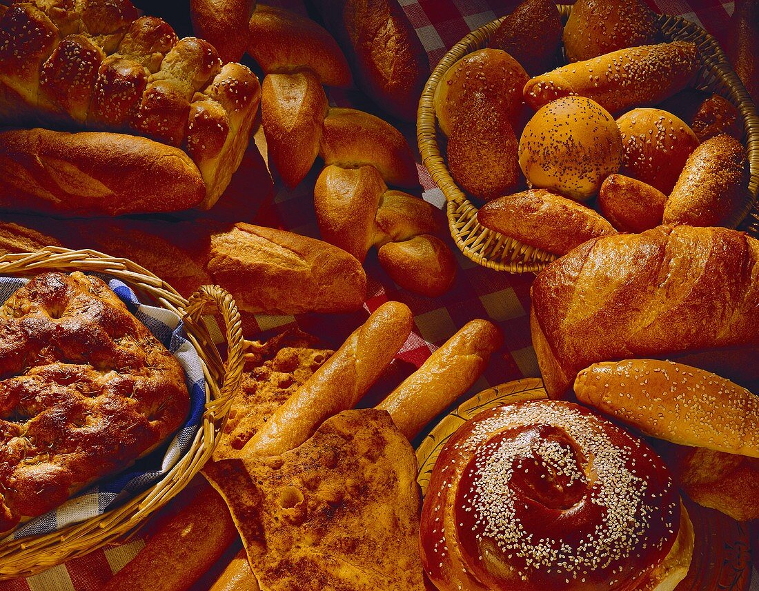 Various white breads, rolls and baked goods