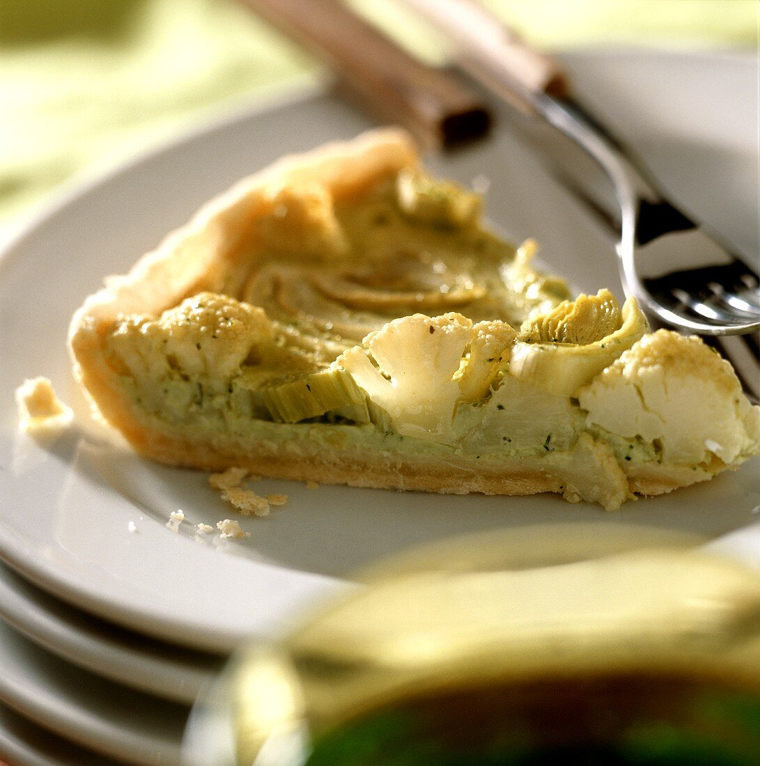 A piece of cauliflower and leek tart on plate