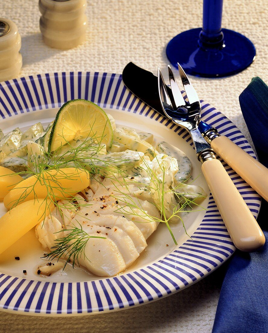 Redfish fillet with dill pickles and boiled potatoes
