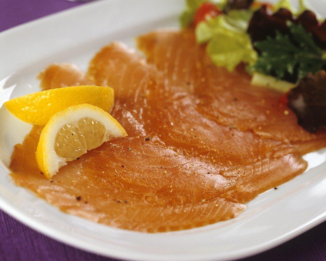 Smoked salmon slices with lemon slices & lettuce garnish
