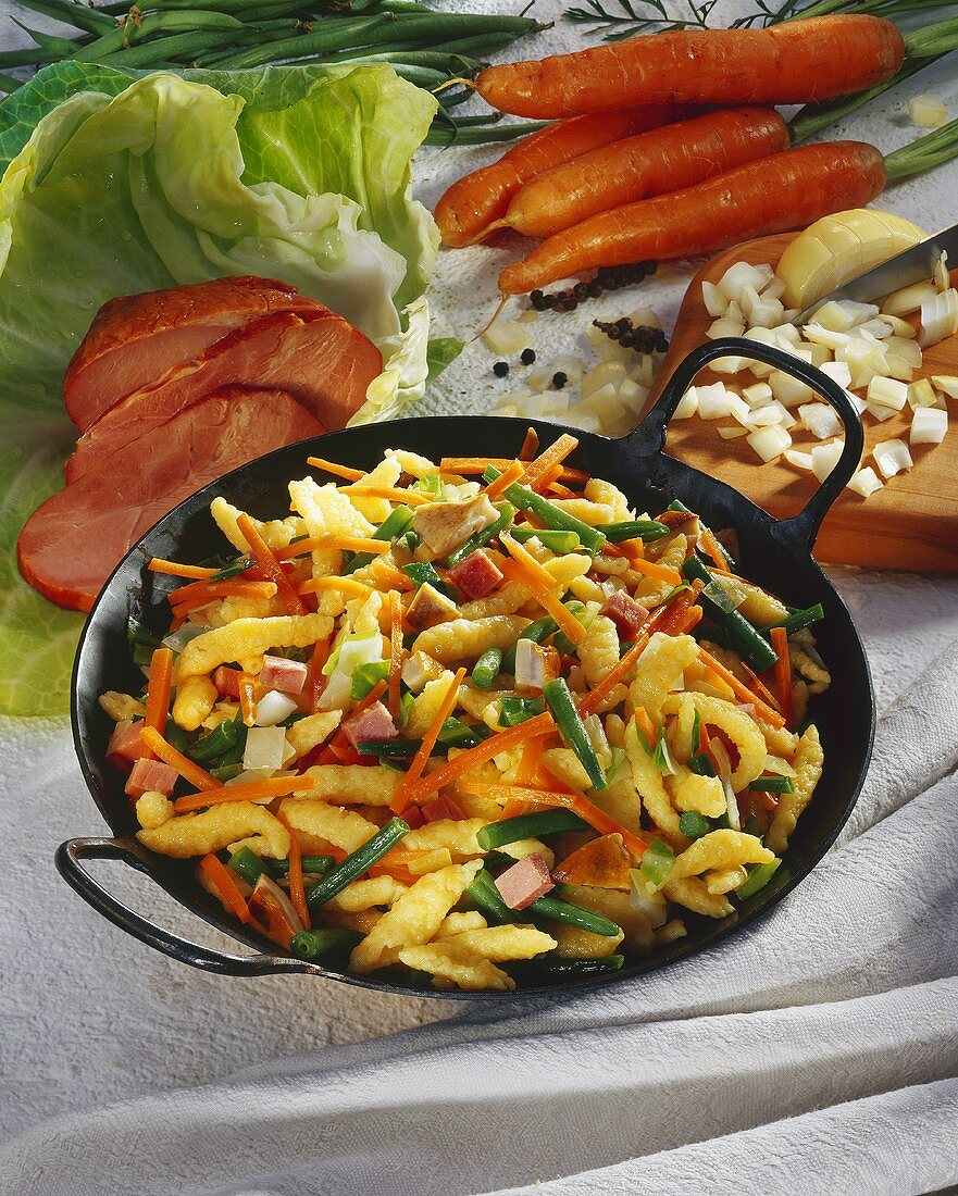 Home-made noodle pan with vegetables & smoked turkey breast