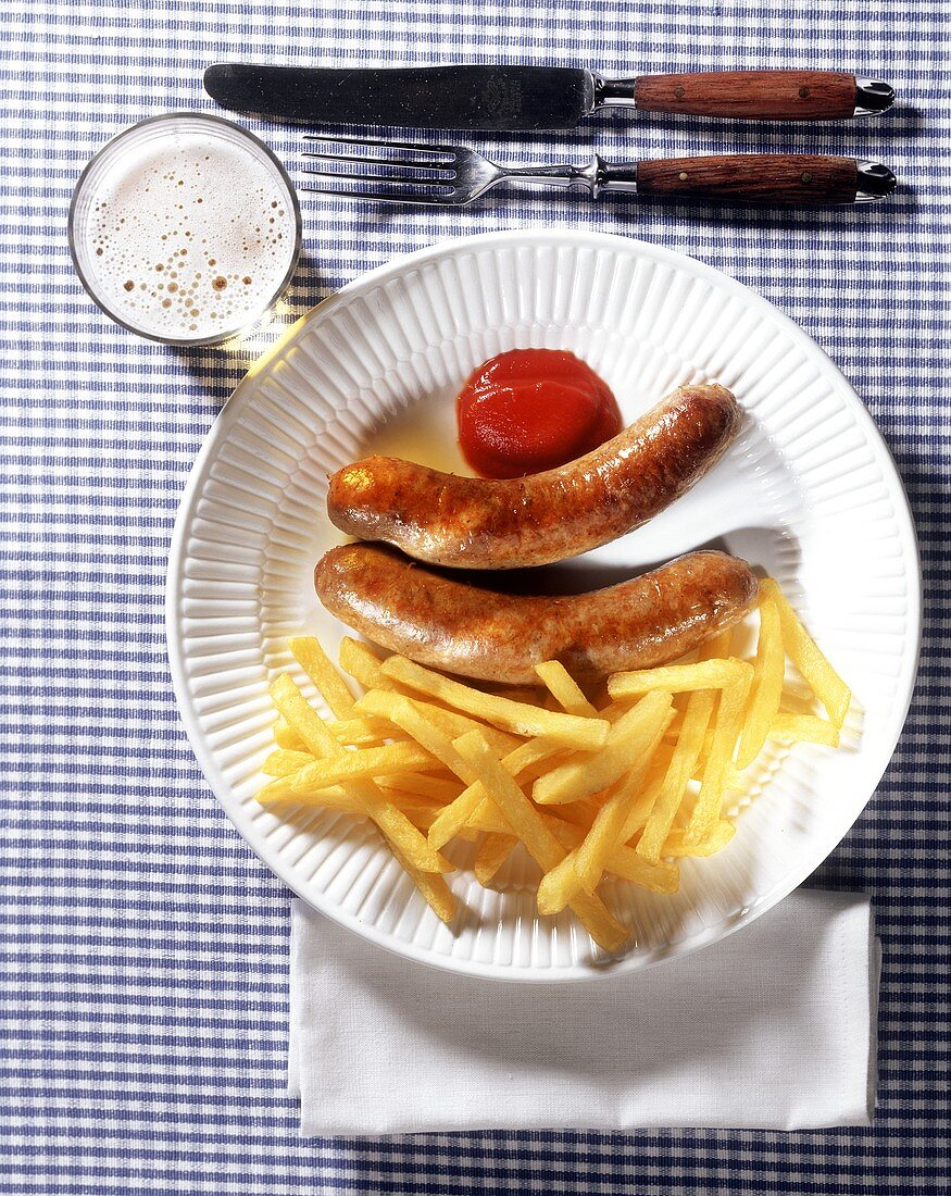 Sausages with chips, ketchup and beer