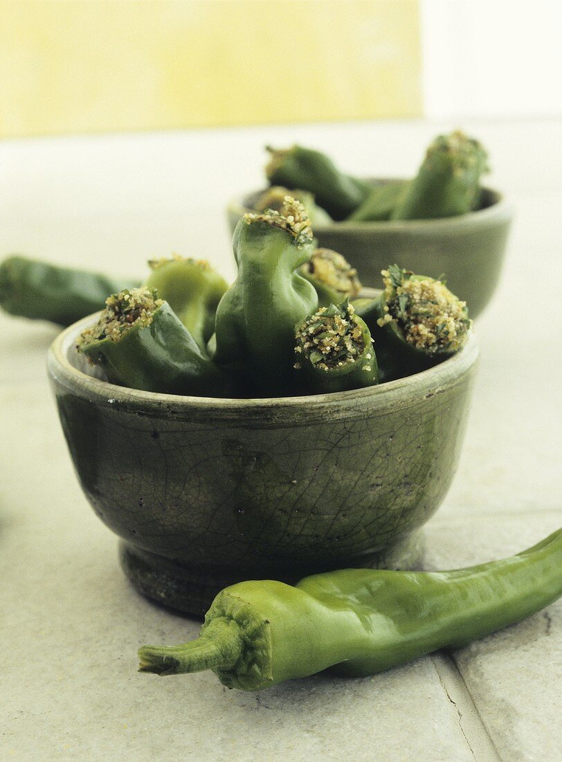 Stuffed green chili peppers in two bowls