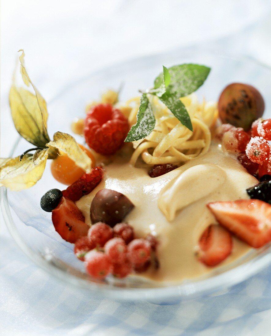 Semolina halva with berries, physalis & mint leaf on plate