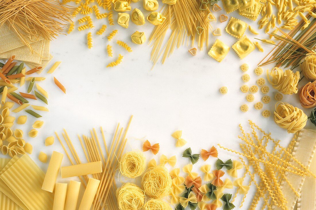 Various types of noodles, grouped round edge of picture