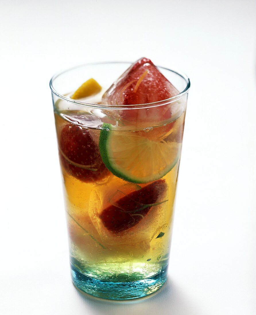 Ice cream berry drink with lime wedges in glass