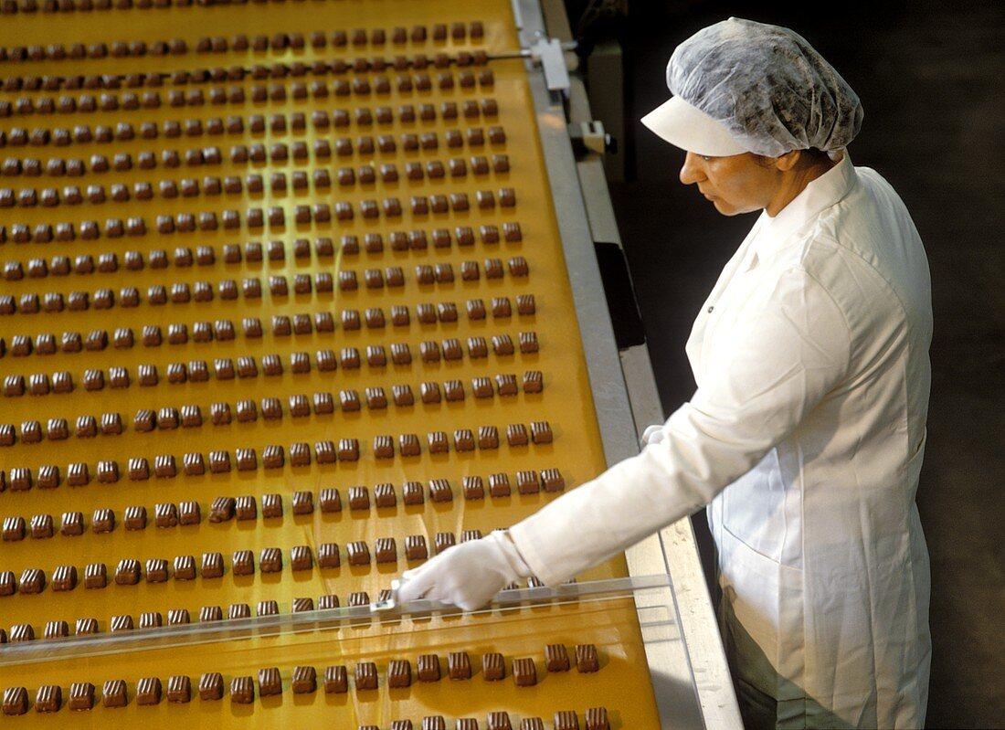 Female worker making chocolates