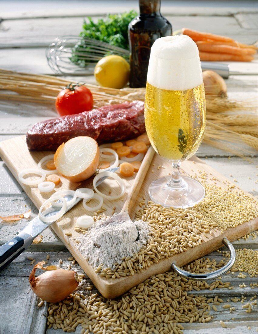 Still life with beer, cereals, flour, vegetables, meat etc