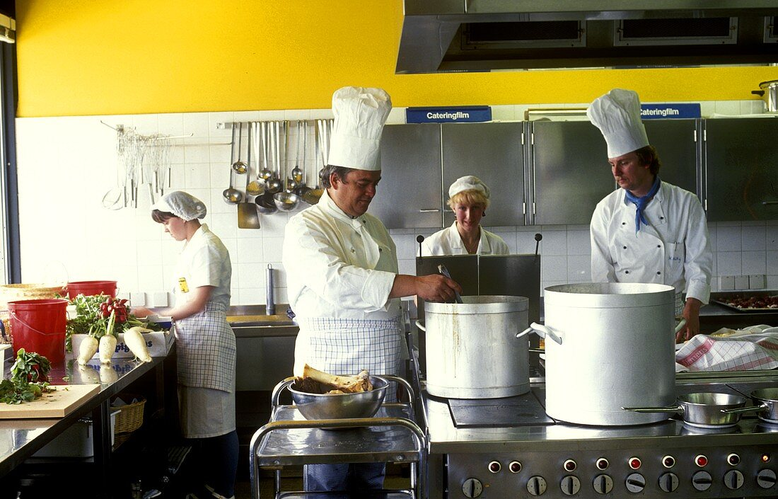 Chefs in a canteen kitchen