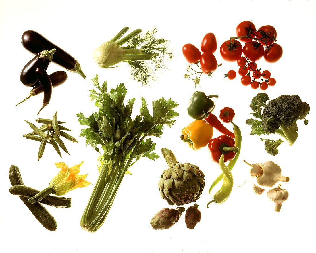Various fresh vegetables, arranged in groups