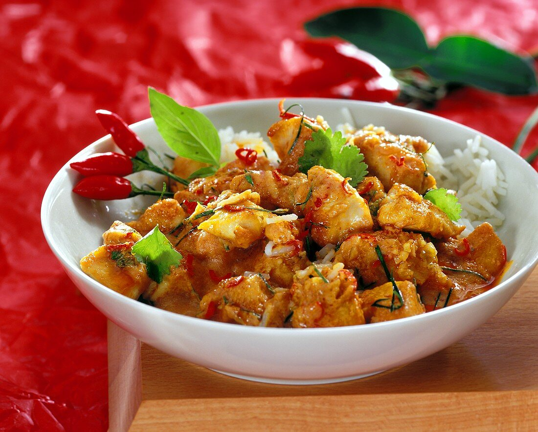 Red chicken curry with chilis and rice