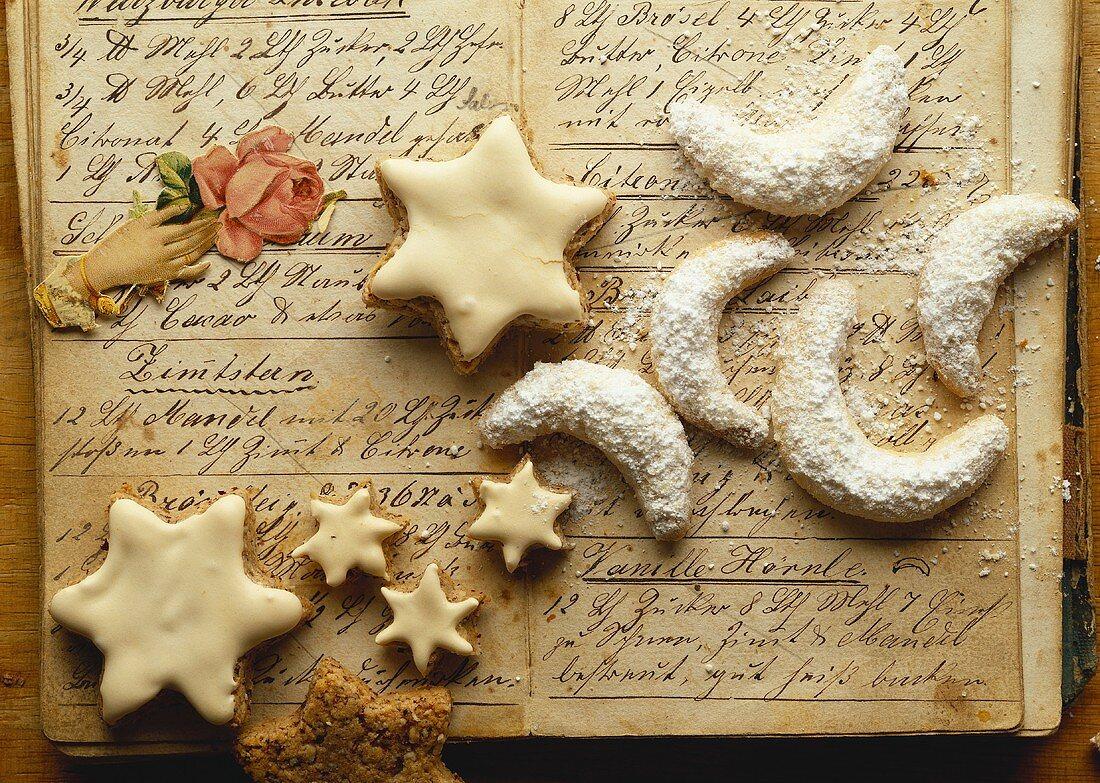 Cinnamon stars & vanilla crescents on hand-written recipes