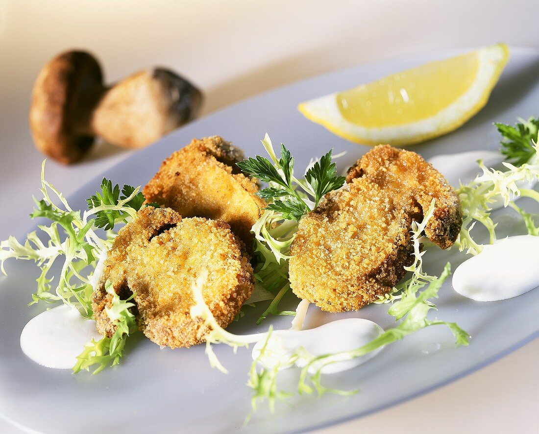 Breaded ceps, garnished with curly endive